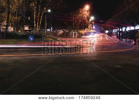 Light trails of cars at a roundabout in Lake Como Italy shot using long exposure.