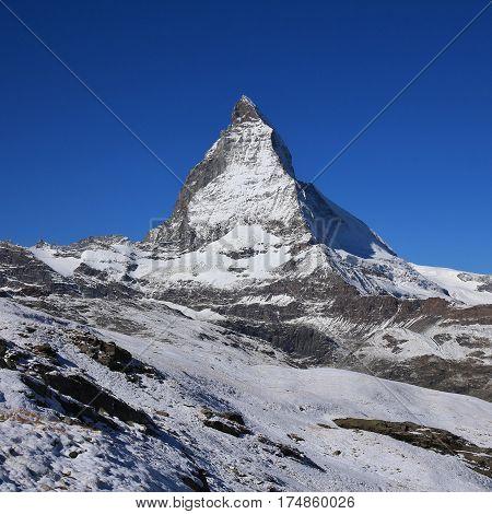 Snow covered Matterhorn. View from Riffelberg Zermatt.