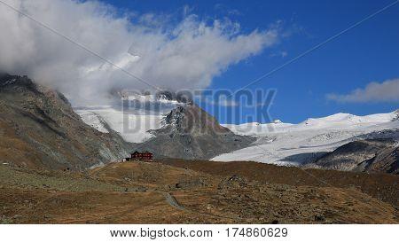Fluhalp Findelgletscher and mountain. View from lake Stellisee Zermatt.