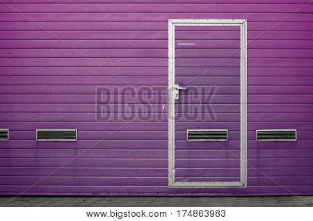 Purple garage gate with ventilation grilles. Large automatic up and over garage door with inclusion of smaller personal door. Multicolor background set