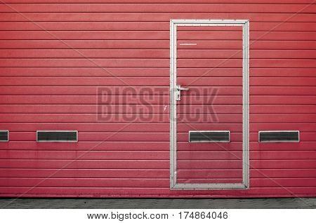 Red garage gate with ventilation grilles. Large automatic up and over garage door with inclusion of smaller personal door. Multicolor background set