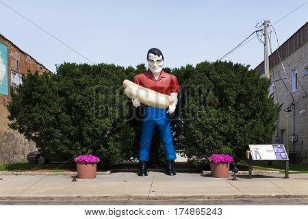 Atlanta Illinois USA - July 5 2014: The Paul Bunyan holding an hot dog statue in the US Route 66 in Atlanta Illinois USA