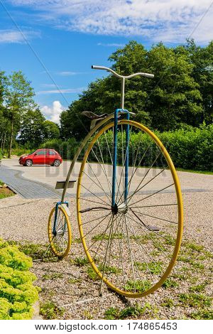 Decorative vintage penny-farthing bicycle in summer garden