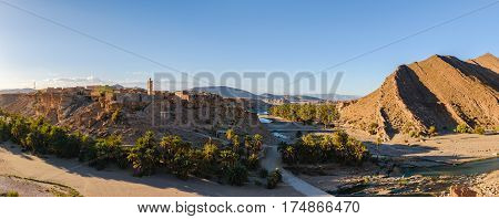 Panorama of the small village Trit near Tata with a Oasis of Palms and the Oued Tissint in Morocco.