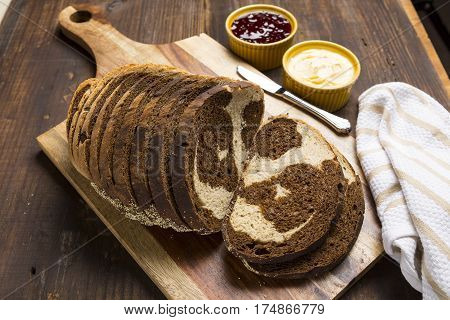 Pumpernickel and rye swirl bread Slices on cutting board
