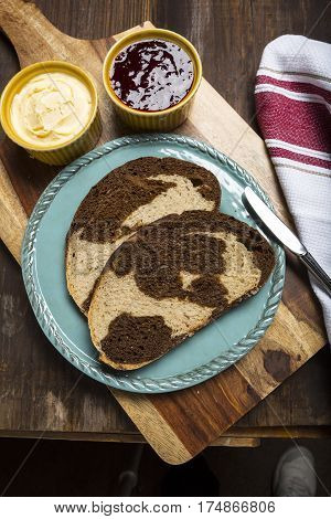 Pumpernickel and rye swirl bread Slices on blue plate and on cutting board