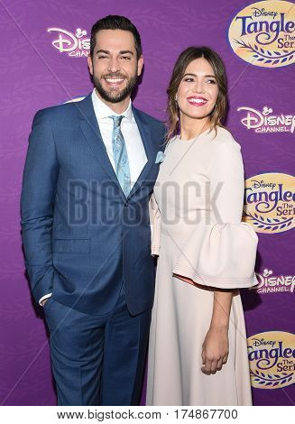 LOS ANGELES - MAR 04:  Zachary Levi and Mandy Moore arrives for the