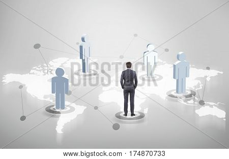 Man figures and a businessman in a suit standing on different continents on a world map. Concept of international trade and globalisation.