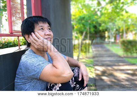 Lonely Senior Woman Sitting Outside