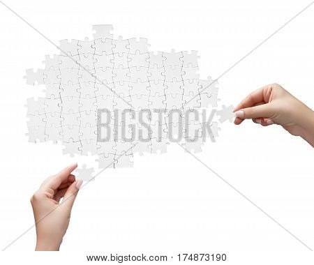 Hand Holding A Piece Of White Uncompleted Puzzle