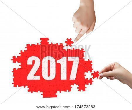 Hand Holding A Piece Of White 2017 Puzzle