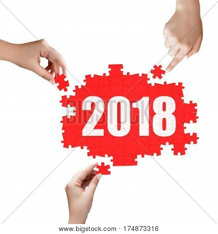 Hand Holding A Piece Of 2018 Puzzle