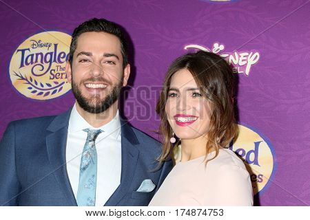 LOS ANGELES - MAR 4:  Zachary Levi, Mandy Moore at the