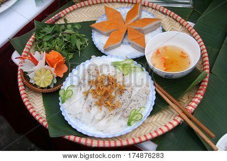 Vietnamese stuffed pancake or banh uot on bamboo tray