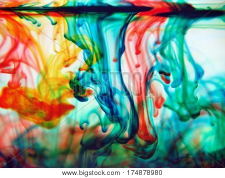 abstract yellow red blue green colors blending into water
