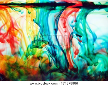 Abstract blue green red yellow colors blending into water