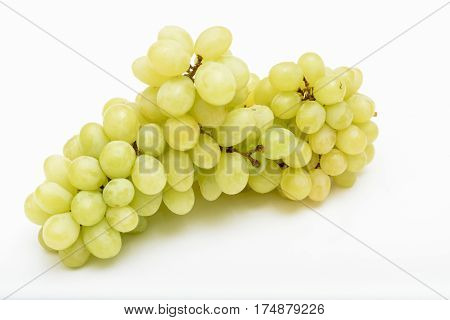 Organic seedless white grapes on a white background
