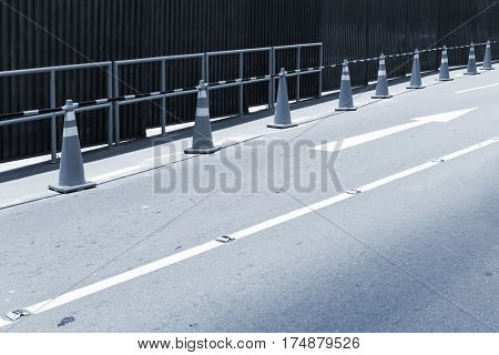 fence on the road on a city street