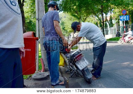 Vietnamese People Fill The Gas Tank In Motorcycle