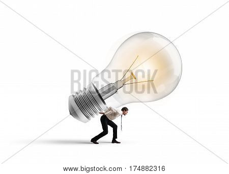 Businessman holds a big light bulb. Have a great idea to be realized concept