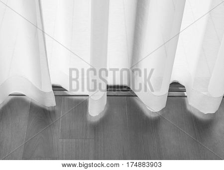 Translucent curtain at the front door with wooden floors. Curtains for the background Black and white concept