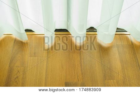 Curtain glazed sliding doors with wood flooring, background curtain, shadow through the curtain