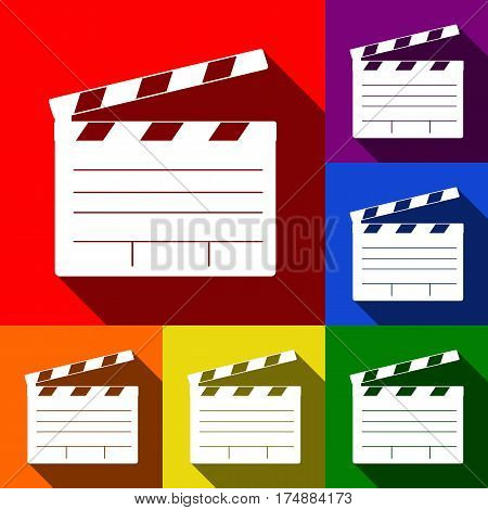 Film clap board cinema sign. Vector. Set of icons with flat shadows at red, orange, yellow, green, blue and violet background.