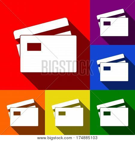Credit Card sign. Vector. Set of icons with flat shadows at red, orange, yellow, green, blue and violet background.