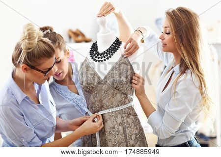 Team of women working on mannequin in atelier