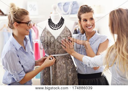 Team of women working on mannequin in atelier
