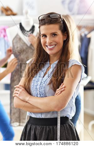 Smiling shop manager in front of her boutique