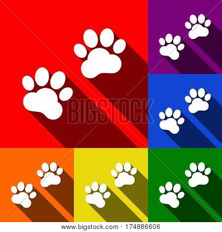 Animal Tracks sign. Vector. Set of icons with flat shadows at red, orange, yellow, green, blue and violet background.