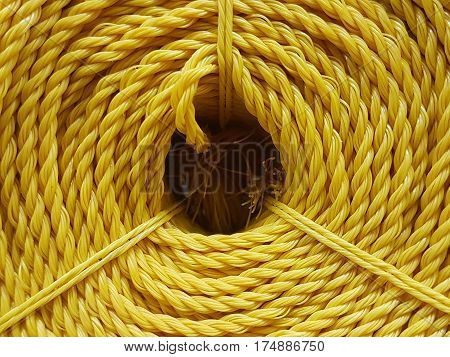Closeup the colorful nylon roll in shop background,Color nylon rope texture,abstract of roll of nylon rope for background used.
