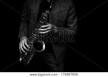 male jazz saxophone player on the stage with leather jacket black and white color
