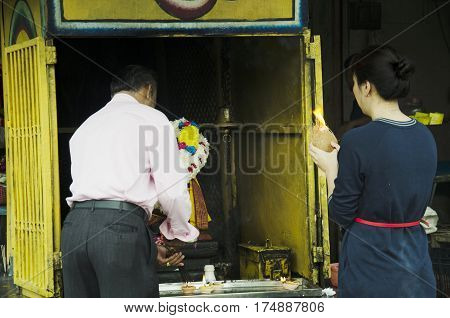 Malaysian People Ritual And Pay Respect To God At Hindu And Chinese God Shrine