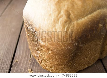 Bread white bread baked homemade bread on a wooden table bread from a stove