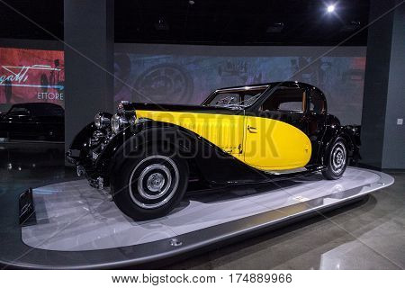 Los Angeles CA USA -- March 4 2017: Yellow and black 1935 Bugatti Type 57 Ventoux at the Petersen Automotive Museum in Los Angeles California United States. Editorial only.