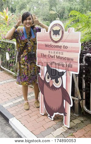 Traveler Thai Woman Portrait With Advertising Boards For Information And Guide Of Owl Museum