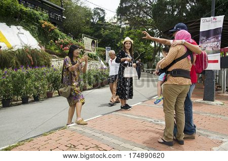 Traveler Thai Women Helping Take Photo For Travellers Malaysian Family