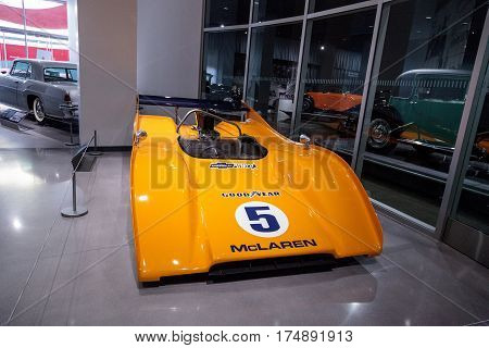 Los Angeles CA USA -- March 4 2017: Orange 1971 McLaren M8E race car at the Petersen Automotive Museum in Los Angeles California United States. Editorial only.