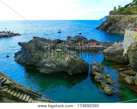 The rock beach at Mediterranean sea at Manarola, Cinque Terre, Italy