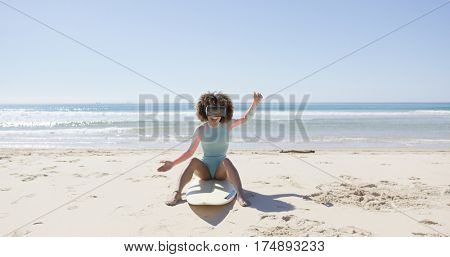 Female on beach wearing virtual reality glasses
