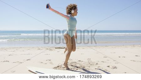 Female listening to music on beach