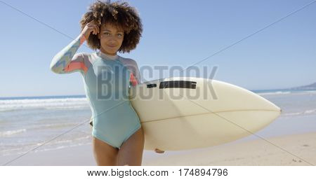 Female with surfboard posing on sea background