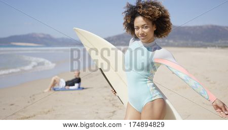 Female posing with surfboard