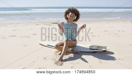 Female listening music on beach
