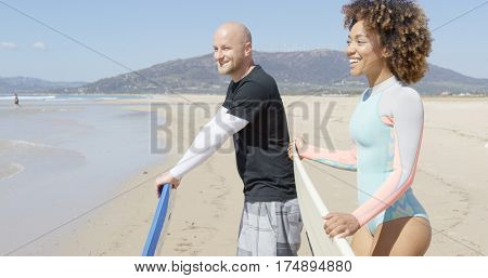 Cheerful surfers on a beach