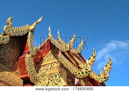 Details of northern style Thai temple roof against clear blue sky at Wat Phra That Doi Suthep A famous Theravada buddhist temple at Chiang Mai Thailand