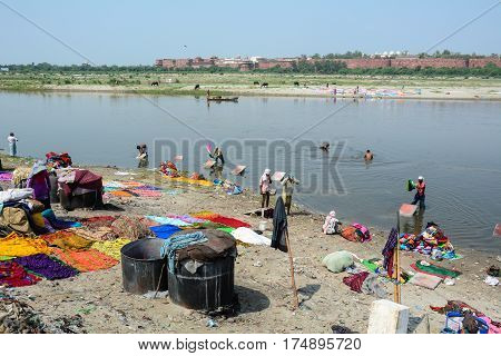 Washing And Drying Clothes On The Sandy Banks