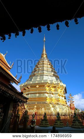 Golden pagoda against clear blue sky at Wat Phra That Doi Suthep A famous Theravada buddhist temple at Chiang Mai Thailand